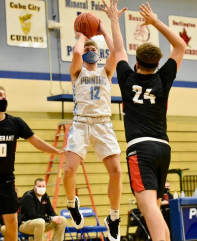 Boys Basketball Emerges Victorious Over Cambridge